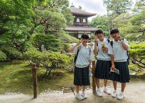 three people in their school uniform
