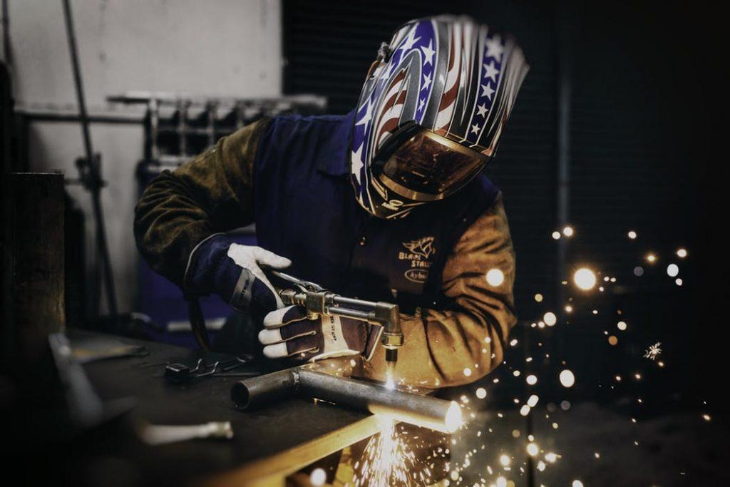a worker using a laser cutter