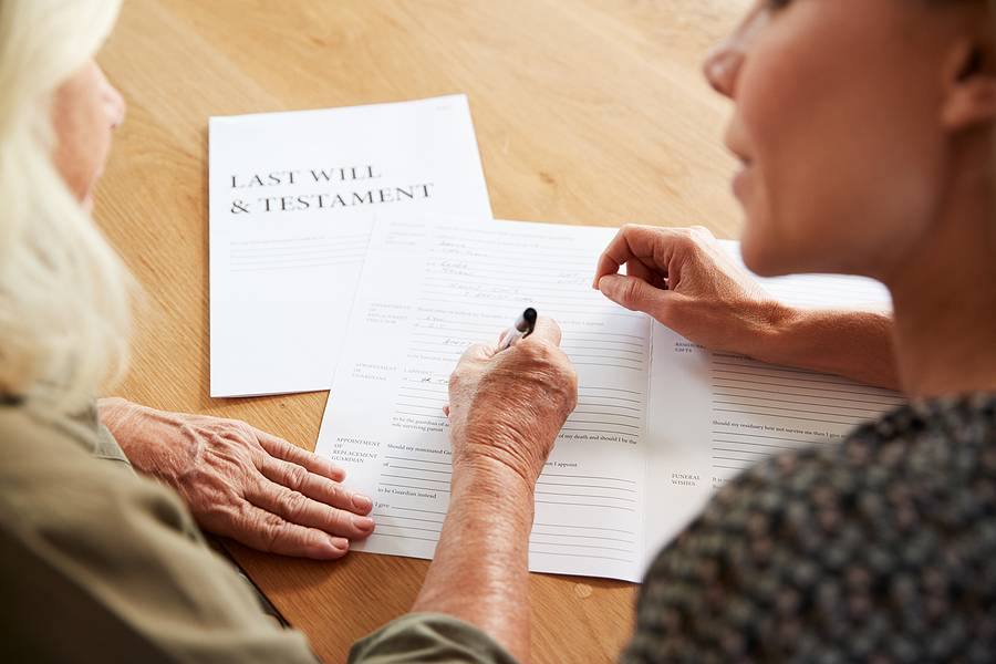 Wills and estate Campbelltown specialist helping an old woman to finalize her will